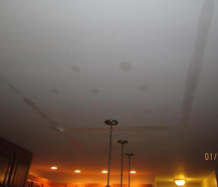 Photo of water damaged ceiling