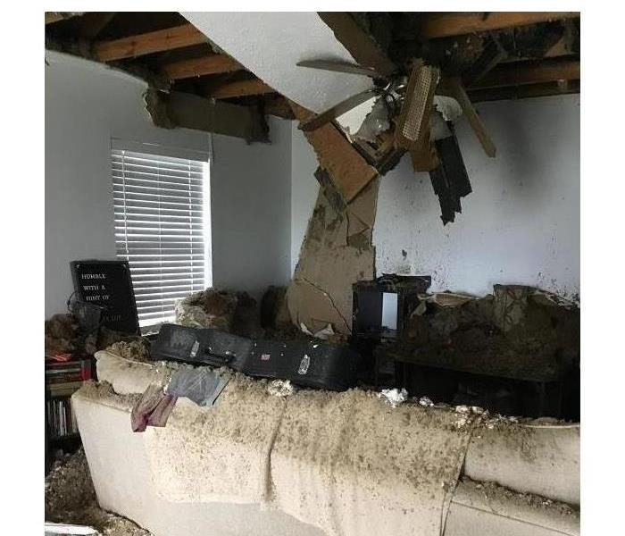 Debris from outside and the neighbors home is present inside our customer's living room.
