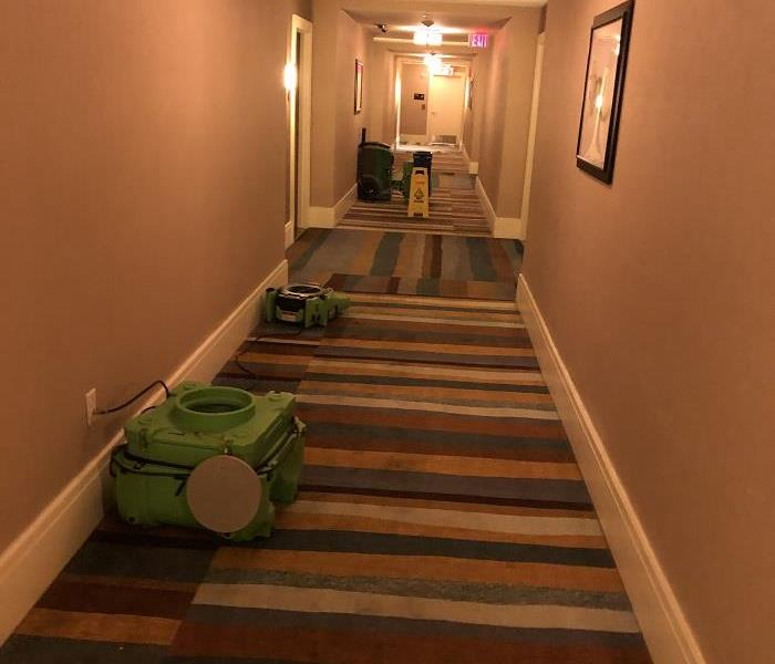 Photo of hotel hallway with drying equipment