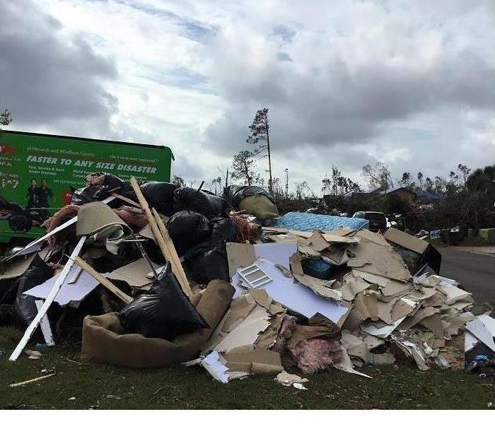 Large debris piled outside a home in Florida after the hurricane.