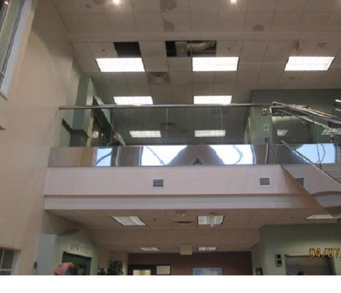 water damage to the ceiling tiles at a large bank headquarters